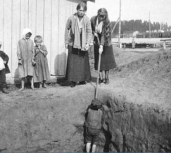 Grand Duchess Olga and Grand Duchess Anastasia with peasant children in Mogilev.