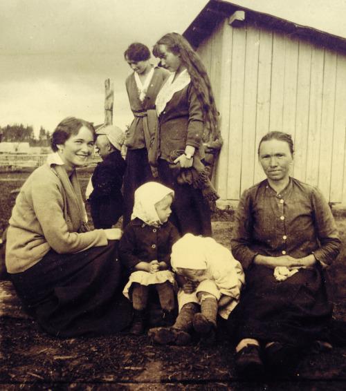 Grand Duchess Olga, Grand Duchess Tatiana and Grand Duchess Anastasia with peasant children in Mogilev.
