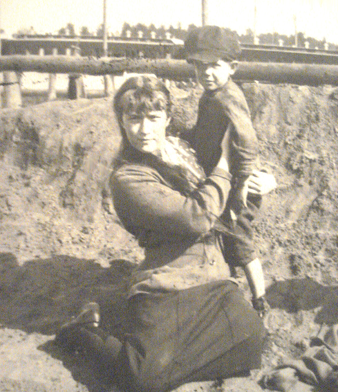 Grand Duchess Anastasia with a peasant child in Mogilev.