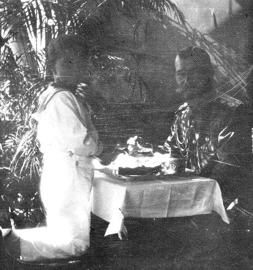 Nicholas II and Tsarevich Alexei at tea