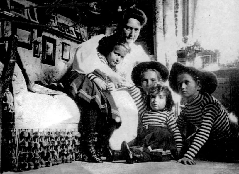 Empress Alexandra, Grand Duchesses Olga, Tatiana, Anastasia and Tsarevich Alexei in their mother's bedroom at the Alexander Palace.