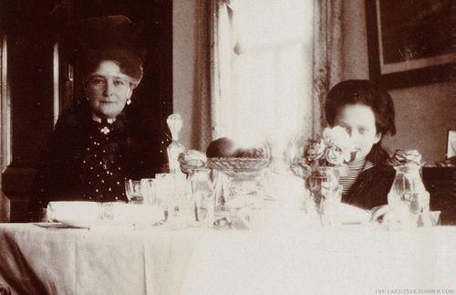 Empress Alexandra and Grand Duchess Tatiana at a dinner table.