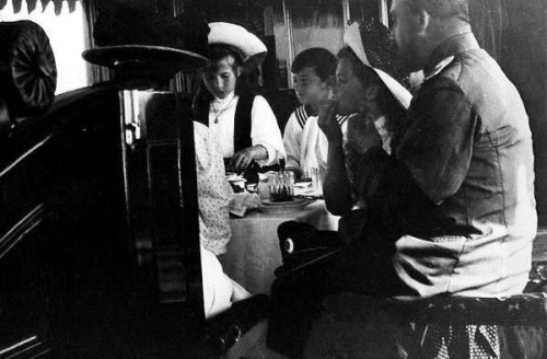 The Romanov family at a meal