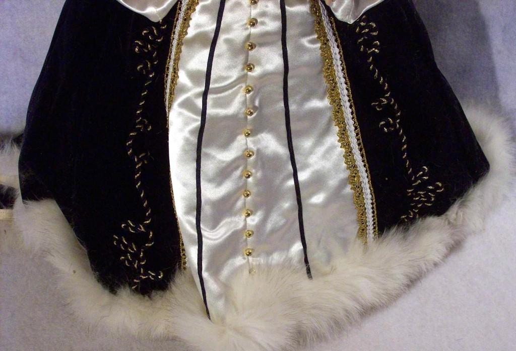 Close up of the dress of Empress Alexandra Romanov doll
