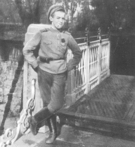 Tsarevich Alexei posing with a cigarette