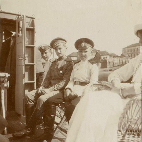 Alexei Romanov with the Derevenko brothers.